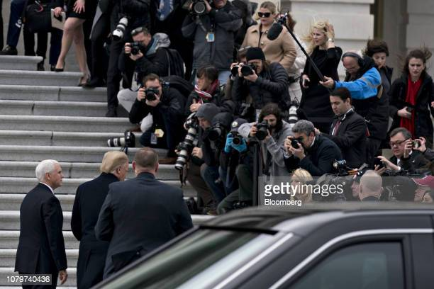 US President Donald Trump second left speaks to members of the media while arriving to the US Capitol for a meeting with Senate Republicans and US...