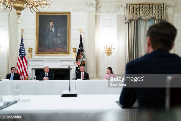 President Donald Trump, second left, speaks while Steven Mnuchin, U.S. Treasury secretary, from left, U.S. House Minority Leader Kevin McCarthy, a...
