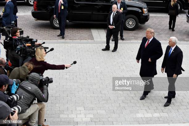 US President Donald Trump second right and US Vice President Mike Pence right arrive for a Senate Republicans policy luncheon at the US Capitol in...