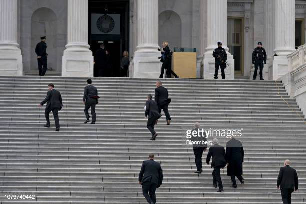 US President Donald Trump second right and US Vice President Mike Pence third right arrive to the US Capitol for a meeting with Senate Republicans in...