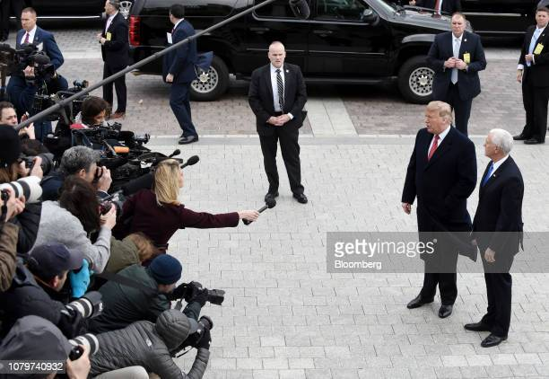 US President Donald Trump second right and US Vice President Mike Pence right speaks to members of the media while arriving for a Senate Republicans...