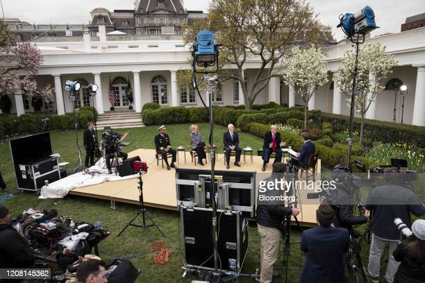 US President Donald Trump second right and US Vice President Mike Pence third right participate in a Fox News virtual town hall in the Rose Garden of...