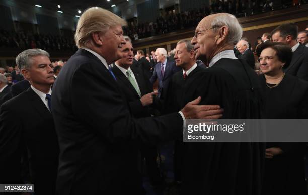 US President Donald Trump second right greets Stephen Breyer associate justice of the Supreme Court right ahead of a State of the Union address to a...