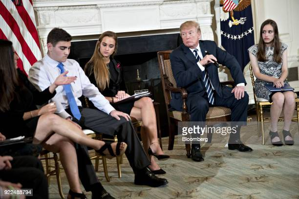 US President Donald Trump second right participates in a listening session on gun violence with high school students teachers and parents in the...