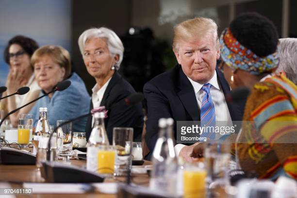 US President Donald Trump second right shakes hands with Winnie Byanyima executive director of Oxfam International after arriving late for the Group...