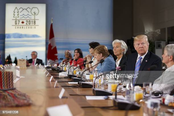 US President Donald Trump second right sits after arriving late for the Group of Seven Gender Equality Advisory Council Breakfast at the G7 Leaders...