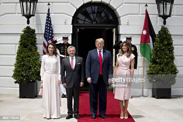 US President Donald Trump second right speaks as Rania AlAbdullah Queen of Jordan from left King Abdullah II of Jordan and First Lady Melania Trump...