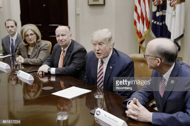 US President Donald Trump second right speaks as Representative Greg Walden a Republican from Oregon right and Representative Kevin Brady a...