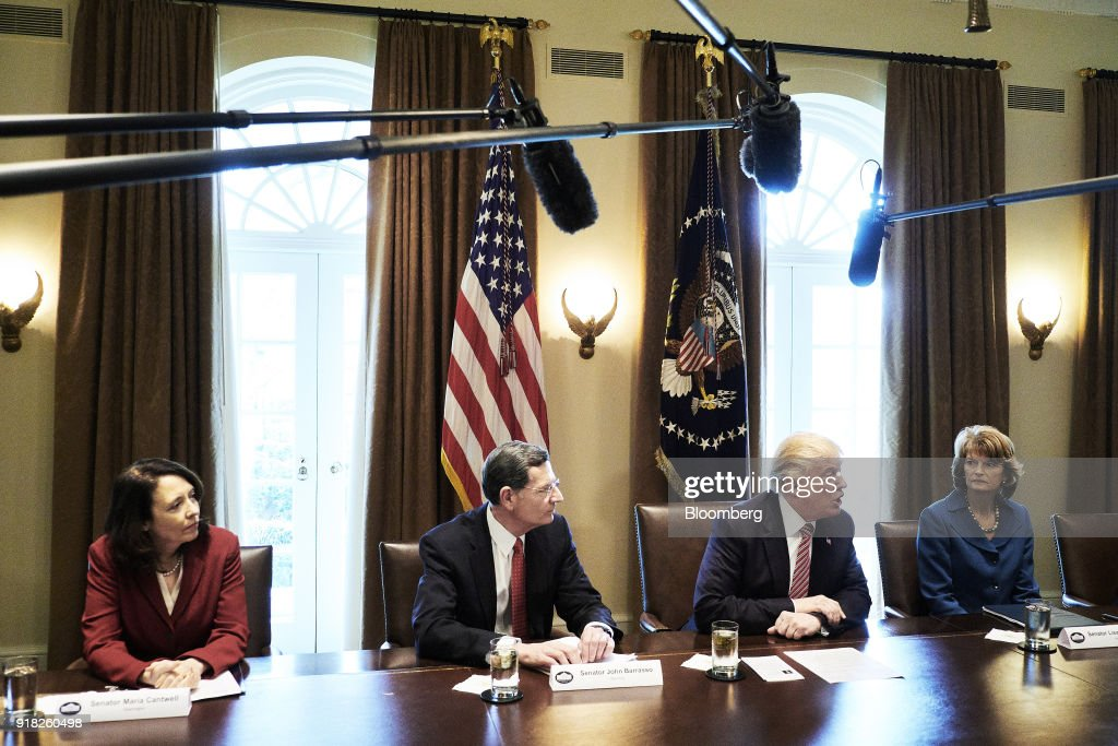 U.S. President Donald Trump, second right, speaks during a meeting with bipartisan members of congress in the Cabinet Room of the White House in Washington, D.C., U.S. on Wednesday, Feb. 14, 2018. Republican lawmakers told Trump the new tariffs hes mulling for aluminum and steel imports would likely do more harm than good, costing greater jobs among automakers and manufacturers than they protect. Photographer: T.J. Kirkpatrick/Bloomberg via Getty Images