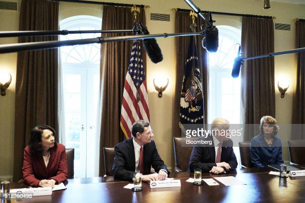 US President Donald Trump second right speaks during a meeting with bipartisan members of congress in the Cabinet Room of the White House in...