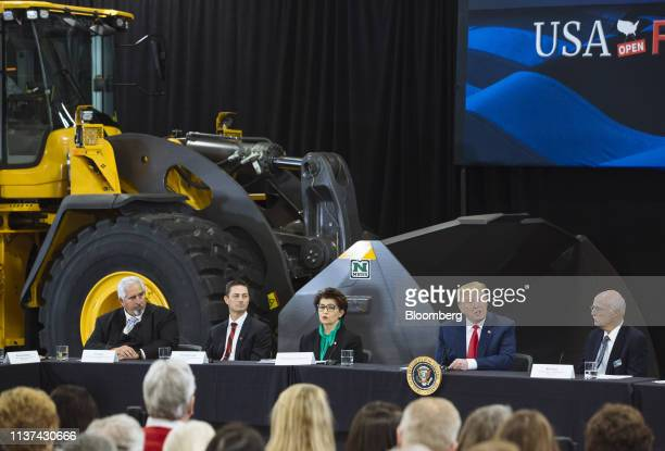 US President Donald Trump second right speaks during a roundtable discussion on the economy and tax reform in Burnsville Minnesota US on Monday April...