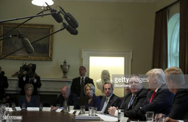 US President Donald Trump second right speaks while Mike Pompeo US secretary of state third right listens during a meeting in the Cabinet Room of the...