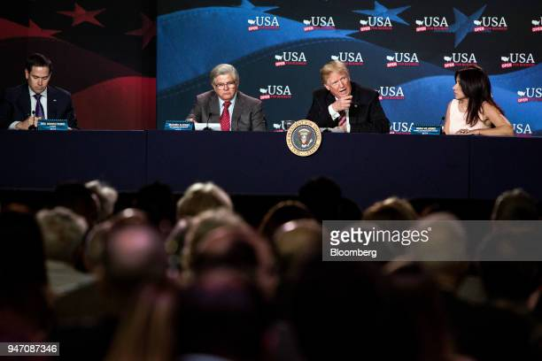 US President Donald Trump second right speaks while Senator Marco Rubio a Republican from Florida from left Maximo Alvarez president of Sunshine...