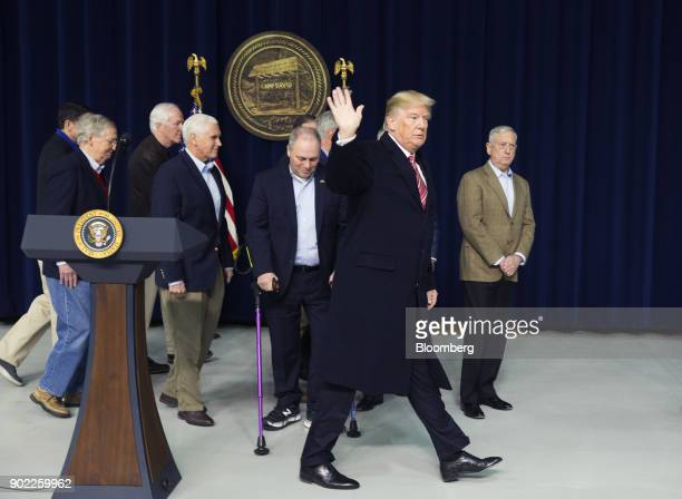 US President Donald Trump second right waves while departing a press conference with cabinet members and Republican leadership at Camp David in...