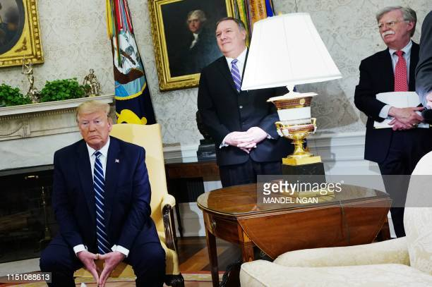 US President Donald Trump Secretary of State Mike Pompeo and National Security Advisor John Bolton are seen during a bilateral meeting with Canada's...