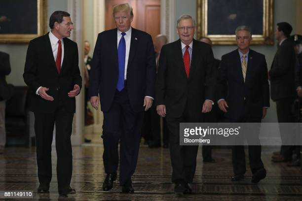 US President Donald Trump Senate Majority Leader Mitch McConnell a Republican from Kentucky second right and Senator John Barrasso a Republican from...