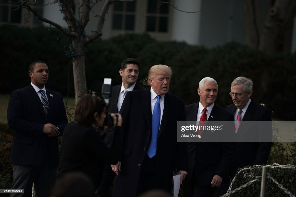 U.S. President Donald Trump (2nd L), Senate Majority Leader Sen. Mitch McConnell (R-KY) (R), Vice President Mike Pence (3rd L), and Speaker of the House Rep. Paul Ryan (R-WI) (L) arrive at the South Lawn for an event to celebrate Congress passing the Tax Cuts and Jobs Act with Republican members of the House and Senate at the White House December 20, 2017 in Washington, DC. The tax bill is the first major legislative victory for the GOP-controlled Congress and Trump since he took office almost one year ago.