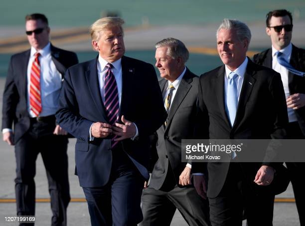 US President Donald Trump Senator Lindsey Graham and Congressman Kevin McCarthy walk to greet supporters after arriving on Air Force One at LAX...