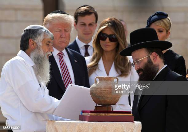 US President Donald Trump senior advisor Jared Kushner first lady Melania Trump and Ivanka Trump the president's daughter listens to Rabbi Shmuel...