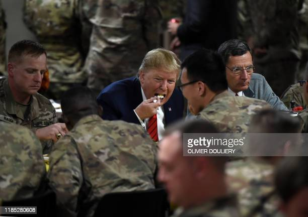 President Donald Trump serves Thanksgiving dinner to US troops at Bagram Air Field during a surprise visit on November 28, 2019 in Afghanistan.