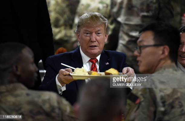 US President Donald Trump serves Thanksgiving dinner to US troops at Bagram Air Field during a surprise visit on November 28 2019 in Afghanistan