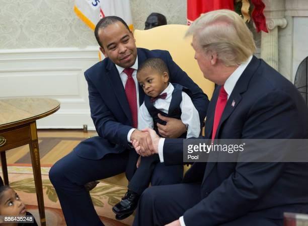 US President Donald Trump shakes Aaron Williams' hand during a meeting with business owners and their families to discussing tax reform in the Oval...