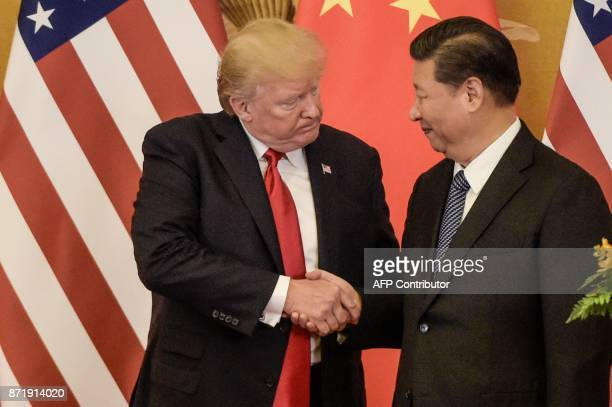 President Donald Trump shakes hand with China's President Xi Jinping at the end of a press conference at the Great Hall of the People in Beijing on...
