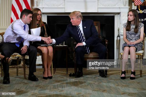 US President Donald Trump shakes hand with Marjory Stoneman Douglas High School shooting survivors Jonathan Blank Julie Cordover and Carson Abt at...