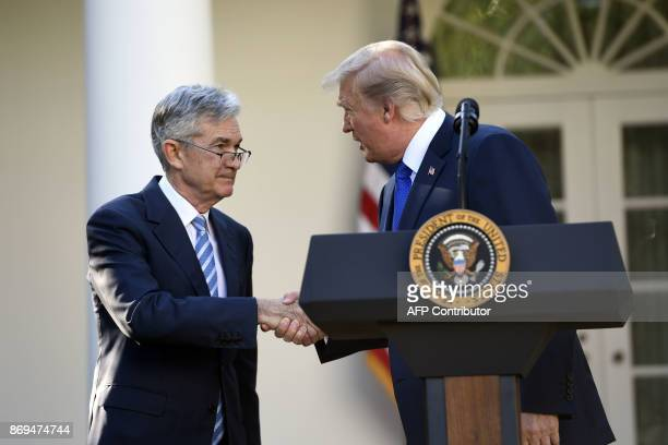 US President Donald Trump shakes hands as he announces his nominee for Chairman of the Federal Reserve Jerome Powell in the Rose Garden of the White...
