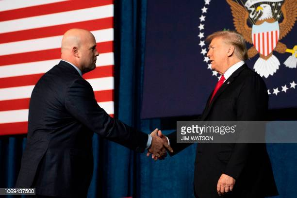 US President Donald Trump shakes hands with Acting US Attorney General Matt Whitaker before speaking at the 2018 Project Safe Neighborhoods National...
