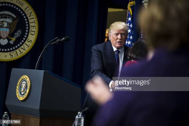 US President Donald Trump shakes hands with an attendee during a 'Conversations with the Women of America' event at the Eisenhower Executive Office...