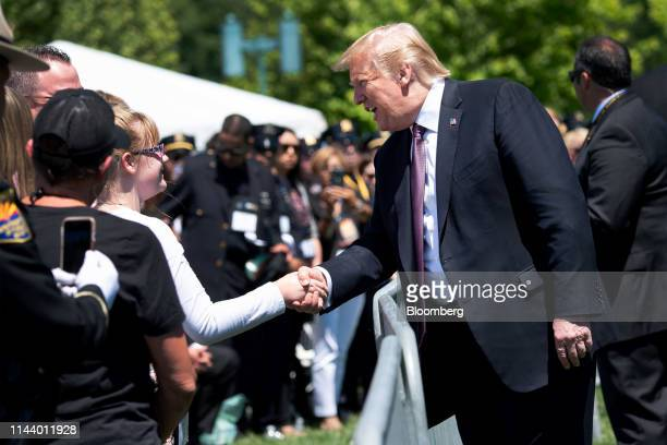 US President Donald Trump shakes hands with an attendee during the 38th annual National Peace Officers Memorial Day service at the US Capitol in...