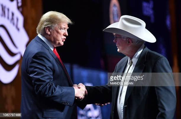 US President Donald Trump shakes hands with Arizona farmer Jim Chilton during the annual American Farm Bureau Federation convention in the Ernest N...
