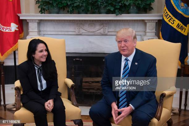 President Donald Trump shakes hands with Aya Hijazi, an Egyptian-American aid worker at the White House in Washington, DC, April 21, 2017. Hijazi was...