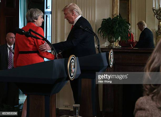S President Donald Trump shakes hands with British Prime Minister Theresa May after a joint press conference in the East Room of the White House...