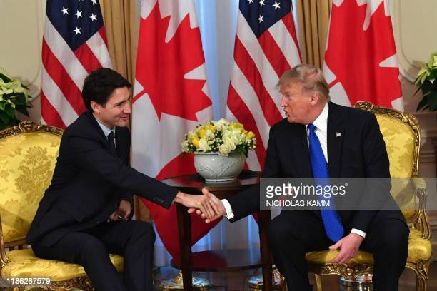 US President Donald Trump shakes hands with Canada's Prime Minister Justin Trudeau during a meeting at Winfield House London on December 3 2019 NATO...