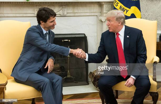 US President Donald Trump shakes hands with Canadian Prime Minister Justin Trudeau during a meeting in the Oval Office at the White House on October...