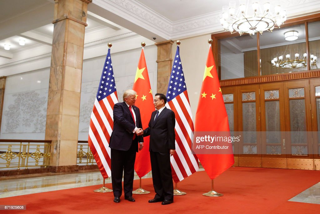 US President Donald Trump (L) shakes hands with Chinese Premier Li Keqiang during a meeting at the Great Hall of the People in Beijing on November 9, 2017. Donald Trump and Xi Jinping put their professed friendship to the test on November 9 as the least popular US president in decades and the newly empowered Chinese leader met for tough talks on trade and North Korea. /