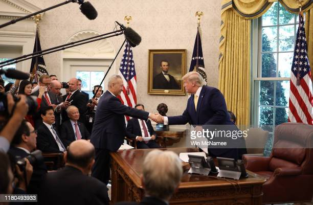 S President Donald Trump shakes hands with Chinese Vice Premier Liu He after announcing a phase one trade agreement with China in the Oval Office at...