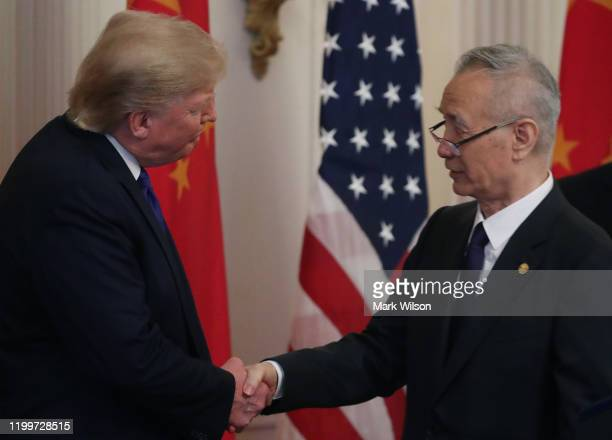 President Donald Trump shakes hands with Chinese Vice PremierLiuHe, before signing the phase 1 of a trade deal between U.S. And China, in the East...