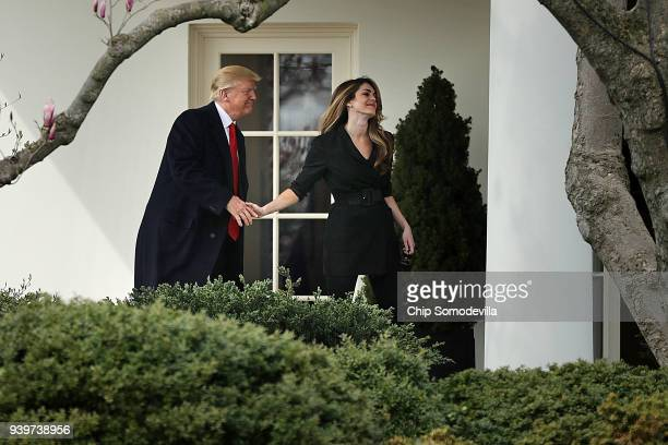 President Donald Trump shakes hands with Communications Director Hope Hicks on her last day of work at the White House before he departs March 29,...