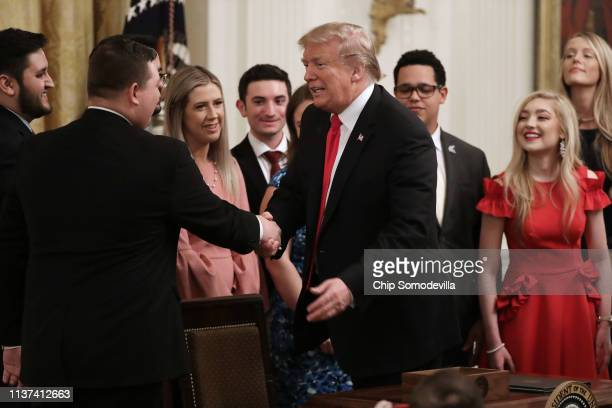 S President Donald Trump shakes hands with current and former college students after signing an executive order protecting freedom of speech on...