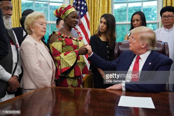 S President Donald Trump shakes hands with Esther Bitrus who was kidnapped by Boko Haram in 2014 in Nigeria while he hosts her and other survivors of...