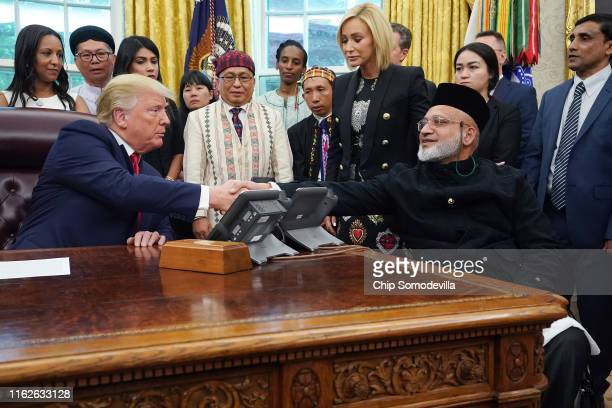 S President Donald Trump shakes hands with Farid Ahmed a survivor of the Christchurch New Zealand terrorist attacks and other survivors of religious...