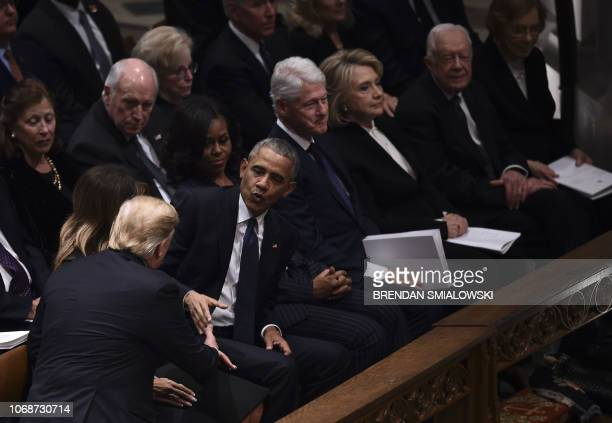 President Donald Trump shakes hands with former US President Barack Obamaas former First Lady Michelle Obama former US President Bill Clinton former...
