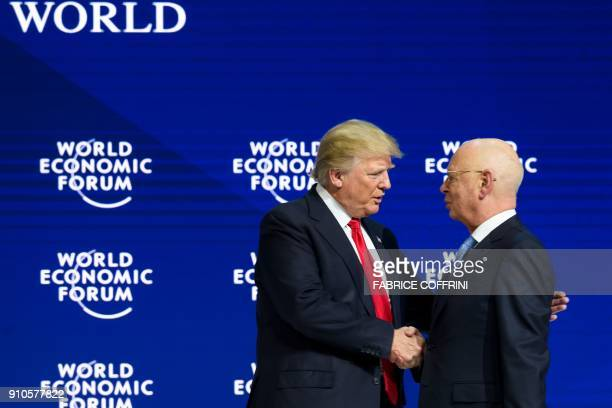 US President Donald Trump shakes hands with founder and Executive Chairman of the World Economic Forum Klaus Schwab after speaking at the World...