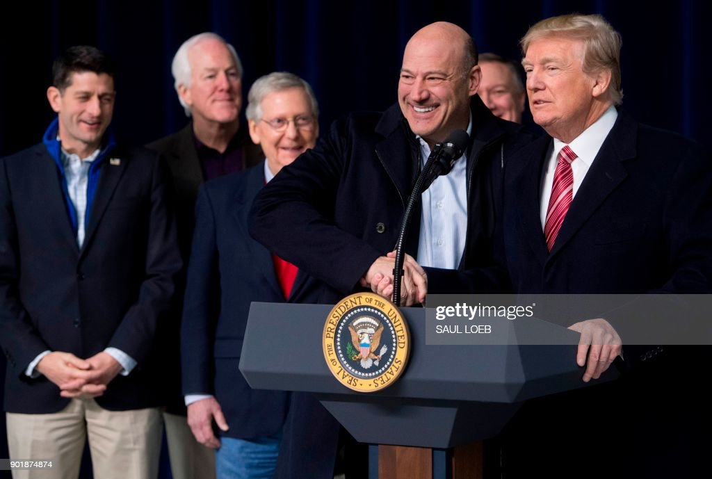 US President Donald Trump shakes hands with Gary Cohn, Director of the National Economic Council, during a retreat with Republican lawmakers and members of his Cabinet at Camp David in Thurmont, Maryland, January 6, 2018. /