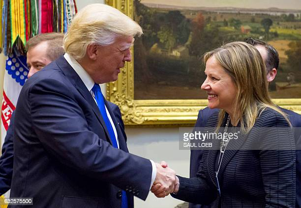 US President Donald Trump shakes hands with General Motors CEO Mary Barra prior to a meeting with automobile industry leaders in the Roosevelt Room...