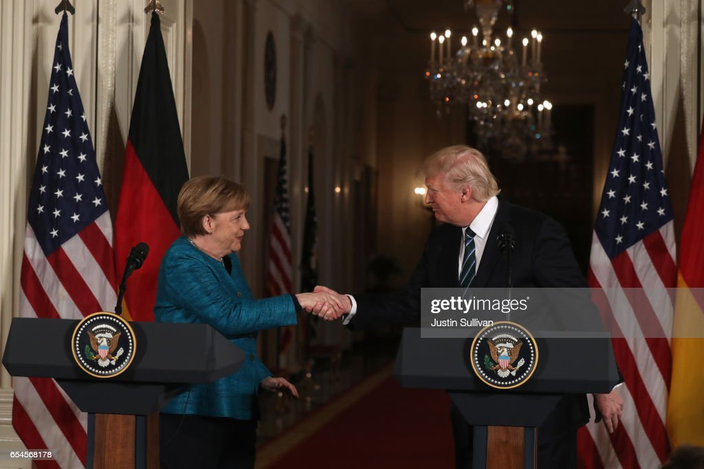U.S. President Donald Trump (R) shakes hands with German Chancellor Angela Merkel during a joint press conference in the East Room of the White House on March 17, 2017 in Washington, DC. The two leaders discussed strengthening NATO, fighting the Islamic State group, the ongoing conflict in Ukraine and held a roundtable discussion with German business leaders during their first face-to-face meeting.