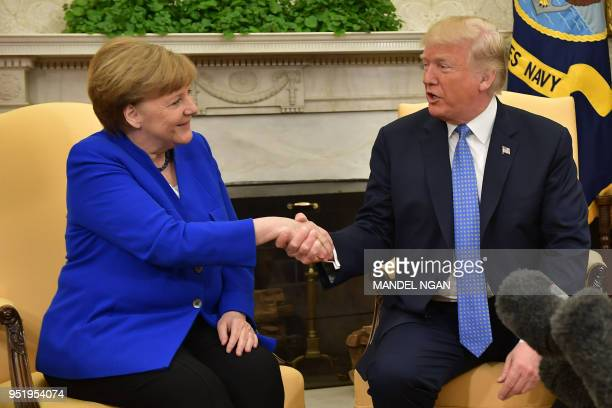 US President Donald Trump shakes hands with German Chancellor Angela Merkel in the Oval Office of the White House on April 27 2018 in WashingtonDC